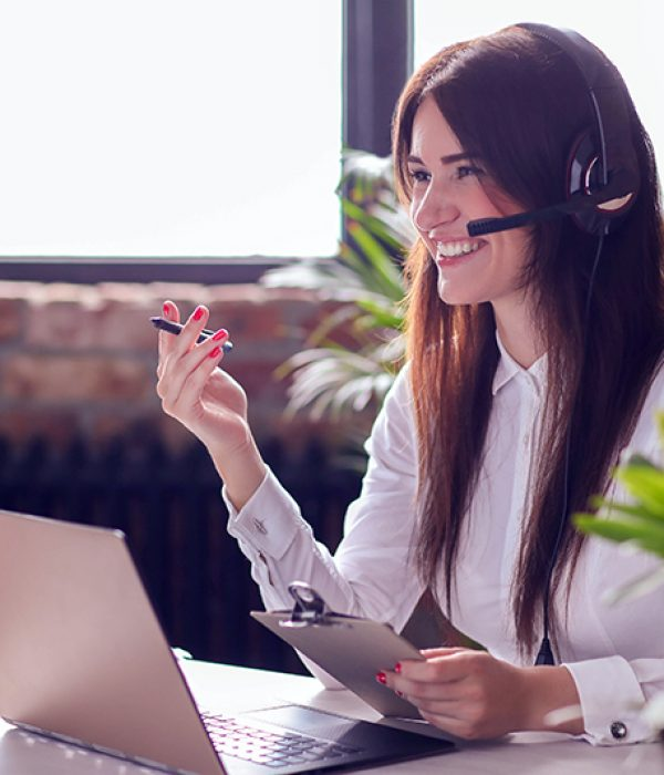 Woman working in call center as dispatcher